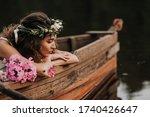 Romantic girl in a boat looks...