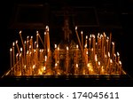 Candles And Orthodox Crucifix.