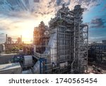 Small photo of Power plant and steam turbine generator natural gas combined cycle with blue sky, Oil and gas refinery industrial zone on sunset, Gas turbine electrical power plant during construction, Gas turbine
