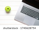 Laptop Keyboard And Green Apple ...