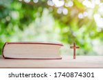 Crucifix And Bible With Bright...