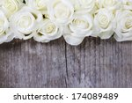 White Roses On Wooden...