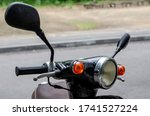 Round Spotlight Of A Moped...