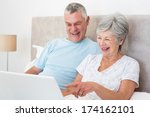 senior couple laughing while... | Shutterstock . vector #174162101