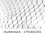 Small photo of Net pattern close up. Rope net . Soccer, football, volleyball, tennis and tennis net pattern. Fisherman hunting net rope texture