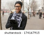 young man reading messages and... | Shutterstock . vector #174167915
