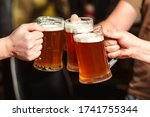 Friends Drinking Beer At Pub....