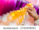 Preparing Row Of Candles In An...
