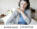shoulder pain in a woman | Shutterstock . vector #174199769