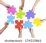 Human Hands Holding Jigsaw...
