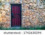 A Purple Metal Door With A...