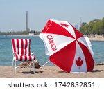 A Canadian Flag Umbrella And...