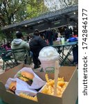 Small photo of New York City, New York - November 2019: Resident and tourist eat at Shack Shack Madison Square for a birthday lunch