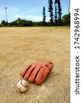 Baseball Ball And Glove On The...