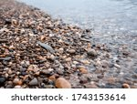 Water Worn Pebbles At The Edge...