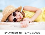 adorable little girl lying on a ... | Shutterstock . vector #174336401