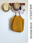 Straw hats, beach bag and swimming glasses summer vacation essentials - stock photo
