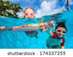 Above And Underwater Photo Of...