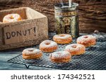 Icing sugar falling on fresh donuts - stock photo