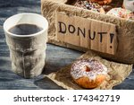 Hot coffee and box with donuts - stock photo