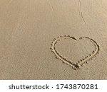 Write Heart On The Sand Beach...