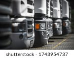 Heavy Duty Transportation industry. Line of New and Pre-Owned Semi Trucks on Dealership Sales Lot. - stock photo