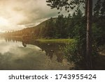 Scenic Lake Somewhere in the Norway. Calm Outdoor Place with Norwegian Landscape. Clean Water, Forest Line and the Mountains. - stock photo