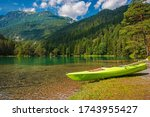Scenic Bavarian Lake Kayaking During Summer Season. Turquoise Lake Water and Alpine Scenery. - stock photo