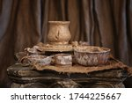 Pottery Cups And Pot Standing...