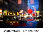 Close Up Of Illuminated Taxi...