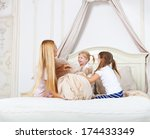 cheerful family having pillow... | Shutterstock . vector #174433349
