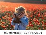 Little Girl Photographs Poppy...