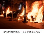 Small photo of ATLANTA, GEORGIA - MAY 29, 2020: Police cars in flames during the protests in Atlanta over the slaying of George Floyd.