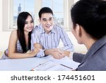 asian couple signing contract... | Shutterstock . vector #174451601
