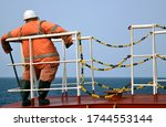 Small photo of Crew member dummy staying on the forecastle of the vessel in Nigerian waters. Anti piracy measures.
