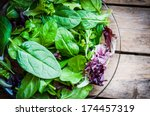 fresh green salad with spinach... | Shutterstock . vector #174457319