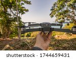 Thailand, Koh Samui - May 2020: DJI Mavic Pro Drone landing to the pilot hand. Scenic Nature Landscape Background. - stock photo