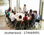businessman addressing meeting... | Shutterstock . vector #174469091