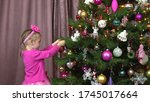 Little Girl Decorates A...