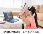 asian girl is studying online...   Shutterstock . vector #1745144231