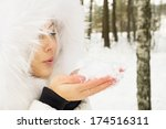 Blonde Blowing Snow On Nature