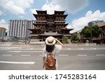 A Woman Tourist Is Traveling A...