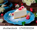 A Piece Of Cheesecake On A Blu...