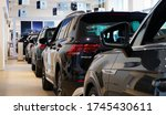 Moscow / Russia - May 25 2020:  New cars at a car dealership. Selected focus on the black Tiguan SUV. Auto business in Russia, sales of new cars, service and maintenance. - stock photo