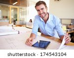 male architect with digital... | Shutterstock . vector #174543104