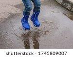 A Little Boy In Blue Rubber...