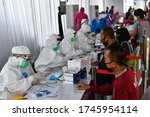 Small photo of SURABAYA, INDONESIA - JUNE 01: Indonesia healthcare workers take mass rapid and swab Covid-19 tests amid the pandemic to stem the spread of Coronavirus and trying to hold the increase of new cases.