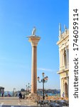 Small photo of Venice, Italy - July 16, 2019: Column of St. Theodore. On the western column is a marble sculpture depicting the warrior Theodore of Tyrone (St. Theodore)
