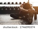 Small photo of Sport and recreation concept. Young athlete exercise in fitness center breaking rest and stretching after strenuous exercise function training workout with personal trainer and healthy lifestyle.