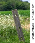 An Old Wooden Fence Post With...